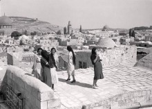 Palestinian women on a rooftop of a house in Jerusalem