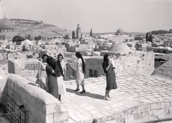 Palestinian women on a rooftop of a house in Jerusalem